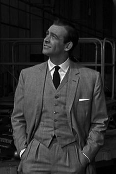 "Sean Connery as ""Bond.James Bond"" in 'Goldfinger' wearing a gray three-piece conduit cut Prince of Whales check suit by Anthony Sinclair of Saville Row. James Bond Suit, Bond Suits, James Bond Style, James Bond Movies, Grey 3 Piece Suit, 3 Piece Suits, Estilo James Bond, Checked Suit, Actrices Hollywood"