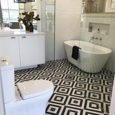 how striking a bold geometric tile on the floor with simple timeless