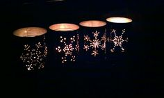 The tin can luminaries I made.