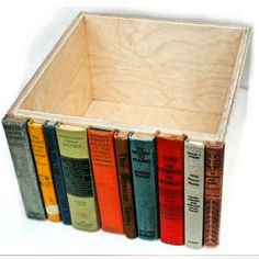 Up-cycled Storage Box. i think i already posted this, but this is DEFINATELY worth the risk of a re-post. if you don't want to waste books, try your local community centre or ask a library if there are any damaged or unusable books you could have.