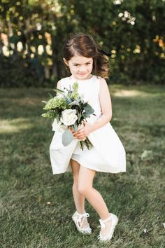Flower girl that is cuter than ever: http://www.stylemepretty.com/new-york-weddings/oakdale/2017/01/11/classic-navy-greenery-wedding/ Photography: Ashley Caroline - http://ashley-caroline.com/