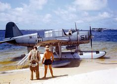 OS2U Kingfisher at the edge of the seaplane ramp at NAS Pensacola, Florida, 1942. A Consolidated P2Y flying boat lays offshore. (Note the ladder/gangway up to the very tall OS2U.