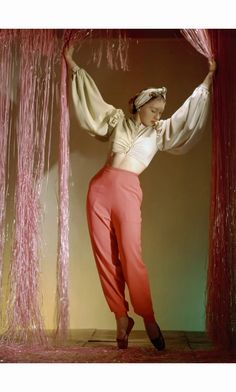 Dancer Irina Baronova standing under curtains wearing harlequin lounging pyjamas with narrow trousers and bare-midriff blouse - Vogue, July 1940 © Horst P. Monte Carlo, 1940s Fashion, Vintage Fashion, Vintage Style, Vintage Vogue, Vintage Glamour, Vintage Inspired, Horst P Horst, Dame Edna