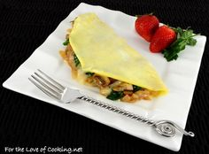 Thin Omelet with Caramelized Onions, Sautéed Mushrooms, Ham, Spinach, and Brie