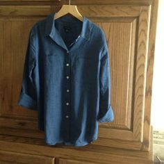 Ann Taylor Shirt Pretty blue button down never worn.  Roll tab sleeves.  100% cotton.  Two chest pockets. Nice detail pattern which is a bit difficult to see in the pics. Ann Taylor Tops Button Down Shirts