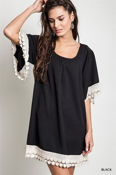 Short Sleeve Lace Trimmed Tunic Dress in Black.