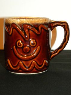 SeLLers descripTion...HULL MIRROR BROWN DRIP GLAZE GINGER BREAD GINGERBREAD MAN MUG FREE SHIPPING ...3 1/2 inches Tall  Has a face on each side.
