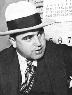 Al Capone was a famous gangster in the He became rich by bootlegging and selling alcohol. He was never caught for his crimes in bootlegging. Real Gangster, Mafia Gangster, Chicanas Tattoo, Tattoos, 1920s Gangsters, Don Corleone, Chicago Girls, Chicago Outfit, How To Read People