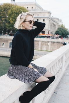 I love the look of the soft flowy skirt paired with a chunky sweater and above-the-knee boots