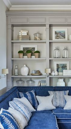 Simple yet stylish, this inspiration for Creative Bookshelf Styling is sure to fill you with ideas for how to decorate your open shelving. The blue, gray, and white color scheme alone is stunning!