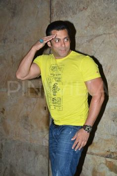 Salman Khan Snapped in Yellow look at screening of Movie
