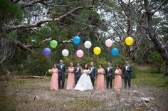 Love the colored balloons for this wedding party photo! Photo by @jadenorwood