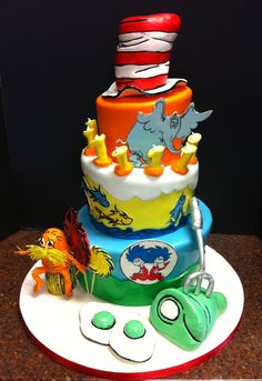 Dr. Seuss First Birthday Cake - This was my first topsy-turvy cake!  What fun!!!  The client wanted lots of Dr. Seuss characters so we went crazy :)
