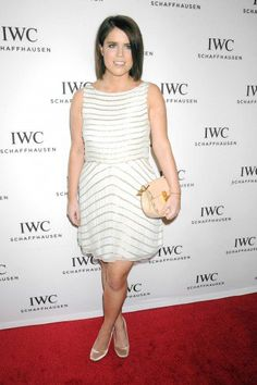 Princess Eugenie opted for a white dress with gold sequins and a gorgeous peach Chloé bag.