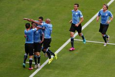 Edinson Cavani of Uruguay (2nd L) celebrates scoring his team's first goal on a penalty kick during the 2014 FIFA World Cup Brazil Group D match between Uruguay and Costa Rica at Castelao on June 14, 2014 in Fortaleza, Brazil.
