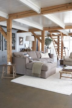 contemporary country living room - pale raw beams against white with soft grey and neutral furnishings