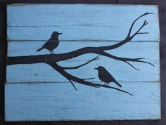 This adorable pallet art was made for my brother and sister-in-law's wedding! The bird and branch silhouette was drawn free-handed and painted on recycled pallets, and then sanded and finished to fit in with their robins egg decor!