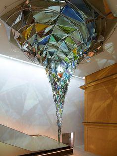 "Lightpublic blogs of Berlin artist Olafur Eliasson's glowing ""Wirbelwerk"" - whirlpool/vortex of colored glass hanging in the atrium of Lenbachhaus in Munich, DE http://buff.ly/1gPizzl"