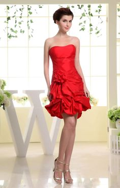 Strapless knee length taffeta dress with bustled bottom and flowers