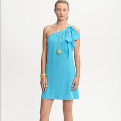"""Trina Turk for Banana Republic dress Electric teal, 100% silk one-shoulder dress. Bow detail with invisible side zip. Excellent used condition. No stains. Tiny snag at the bottom of the dress near hem (refer to fourth photo). 17"""" across from pit to pit. 35"""" length. Offers welcomed Trina Turk Dresses"""