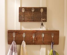 Reclaimed vintage silverware is given new life when installed on old barn wood.