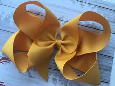 Request: inch Mustard Hair bow made from inch ribbon. inch Mustard Hair Bow made from inch ribbon. As always all hair bows will be heat sealed, hand sewn and shipped in a heavy duty box using USPS first class shipping. Large Hair Bows, Big Bows, Gold Hair Bow, Toddler Hair Bows, Christmas Bows, Boutique Hair Bows, Making Hair Bows, Retro Hairstyles, How To Make Bows