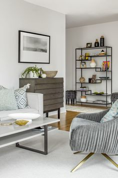"""A geometric <a href=""""http://www.westelm.com/products/tiered-tower-bookcase-h539/?pkey=cbookcases-storage-shelves%7Coffice-storage-bookcases"""">bookshelf</a> adds some visual interest and texture to the room."""