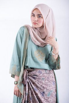 Kebaya in two pieces with sarung. The tunik and Batik ornamen made this dress are rich with the soft colour it look young and elegant. Wear it for party with friends or family gathering. #HijabStyle