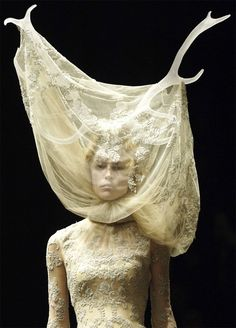 Alexander McQueen - Widows of Culloden, autumn/winter 2006–7 Cream silk tulle and lace with resin antlers - See more at: http://blog.metmuseum.org/alexandermcqueen/dress-widows-of-culloden/#sthash.FbiZ57Qo.dpuf
