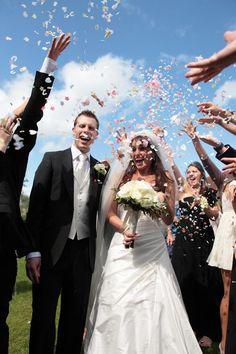 Confetti over bride and groom