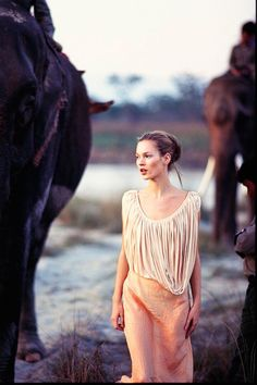 March 1994 In Simply Divine with two elephants. Photo By Arthur Elgort http://www.vogue.co.uk/spy/celebrity-photos/2011/05/19/style-file---kate-moss/viewgalleryframe/394951?