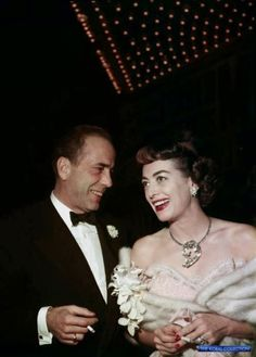 Humphrey Bogart and Joan Crawford....just wonder what they were laughing about...