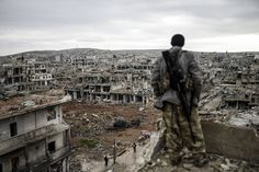 Photographer Bulent Kilic was in Kobani on the Turkish-Syrian border. Here, Musa, a 25-year-old Kurdish marksman, looks down at the ravaged town. Kurdish forces recaptured Kobani in a symbolic blow to the jihadists who have seized large swaths of territory in their onslaught across Syria and Iraq. Photograph: Bulent Kilic/AFP