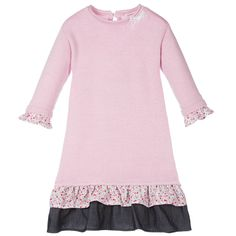 Girls pink sparkling silver knitted dress by Deux Par Deux. Made in a soft wool and angora blend, the style has long sleeves with cotton floral frills at the cuffs and hem and a lace bow detail at the neckline and single button fastening at the back.<br /> <ul> <li>40% viscose, 20% nylon, 27% polyester, 5% wool, 5% angora, 3% silver lurex (soft knit feel)</li> <li>Trims: 100% cotton</li> <li>Hand wash</li> <li>Designer colour: Pink Lady</li> <li>Style name: Jamais Sans Mon Doudou<br />...