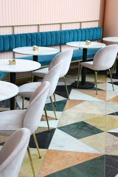 Israeli designer Meir Guri has used dusty pink and multicoloured marble tiles to ensure this restaurant stands out against its shopping centre setting in Tel Aviv. #restaurantdesign