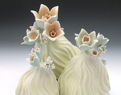 Carved porcelain sculpture with flowers in pastel yellow, aqua, blue & peach