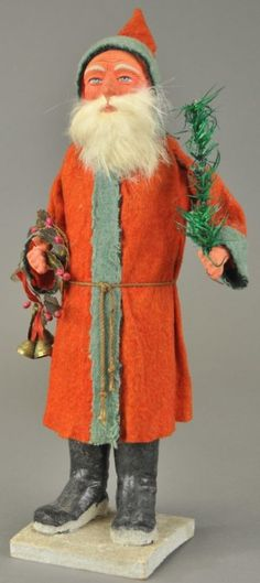 Antique Santa/ Belsnickle Candy Container, with a Red Felt Coat with Blue Trim. Rabbit Fur Beard.