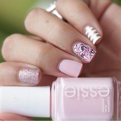 Pink Flower Nails With White and Gold Stripes
