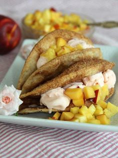 Ice cream taco recipe with cinnamon sugared tortilla shell filled with whipped cream and fresh fruit