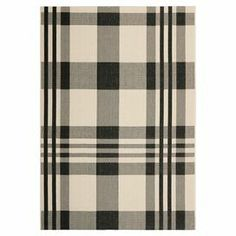 Anchor your patio furniture or add a pop of pattern to your foyer with this versatile rug, showcasing a classic plaid motif.   Product: RugConstruction Material: PolypropyleneColor: Black and boneNote: Please be aware that actual colors may vary from those shown on your screen. Accent rugs may also not show the entire pattern that the corresponding area rugs have.Cleaning and Care: Sweep, vacuum or rinse off with a hose