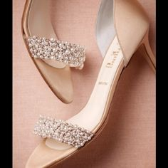 """Oyster Bed D'Orsays - as seen on BHLDN! Encrusted with a lustrous array of the sea's coveted gems, Something Bleu by Butter's satin slip-ons convey the same timeless elegance as an heirloom strand of pearls. Satin and glass pearl upper, leather sole. 2.5"""" satin wrapped heel. Handmade in Italy. Butter Shoes"""
