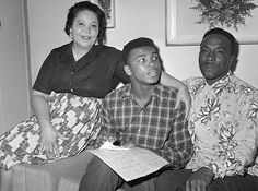 Cassius Clay with his parents in Kentucky