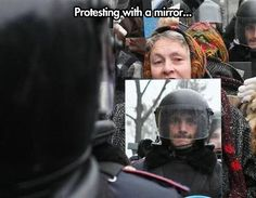 http://cdn.themetapicture.com/media/cool-old-lady-protesting-mirror.jpg