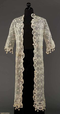 """1 diamond & lattice patterned coat w/ roses at intersections, 3/4 bell sleeves, bauble trims to front opening, sleeves & hems, L 40"""", (1 front & 1 back horizontal brown stain - stored away for decades, may wash out) fair"""