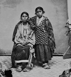 Winnebago Indian woman and daughter photographed in studio circa 1870