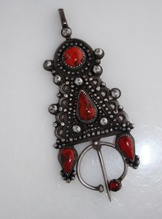 A large, heavy fibula (ibzimen), late 19th, early 20th cent. from Kabylia, Algeria. Silver and coral   2 very similar examples are pictured on page 53 of The Splendor of Ethnic jewelry by Borel-Taylor
