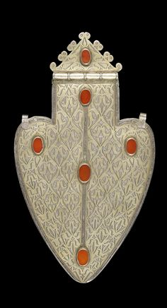 Central Asia | Tekke Turkoman dorsal pendant; parcel gilt silver set with carnelian | ca. 19th century | Est. 1'000 - 1'500£ ~ (Nov '14)
