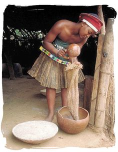 Zulu lady making traditional African beer. The various cuisines of Africa use a combination of o locally available fruits,cereal grains and vegetables, as well as milk and meat products.