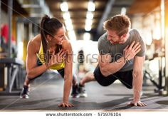 Man and woman strengthen hands at fitness training
