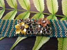Green and gold striped flower bracelet by BlackFoxMT on Etsy